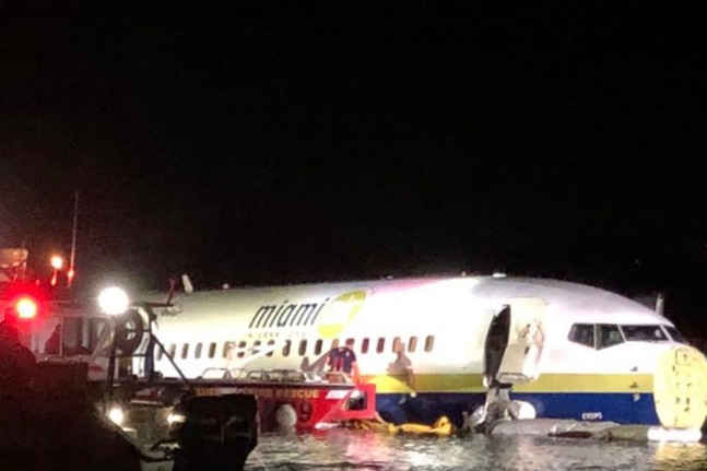 Plane with 140 people aboard skids off runway into Florida river